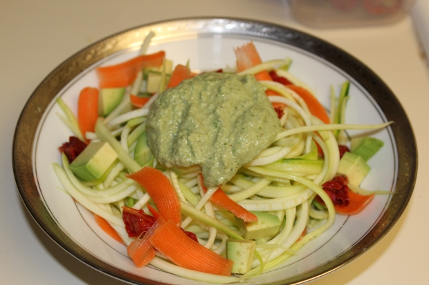 Viola! 5 Minute Basil and Walnut Peso with zucchini noodles, shaved baby carrots, sun dried tomatoes, and avocados.